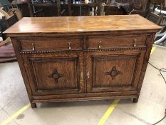 Oak dresser base with two drawers and two cupboards, approx 138cm x 54cm x 97cm tall