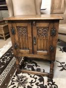 Small oak cupboard with carved detailing