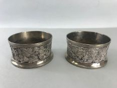 Two Silver coloured Wine coasters with grapes and vine design