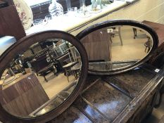 Two bevel edged oval mirrors