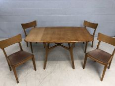 G-Plan (Gold EG stamp to base) cross stretcher dining table with two drop leaves and four matching