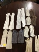 Collection of vintage ladies leather and suede gloves, wrist and elbow length, in a selection of