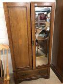 Edwardian inlaid wardrobe with mirrored door and drawer under