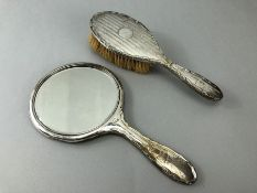 Hallmarked Silver dressing table set comprising of a silver backed Mirror and brush both by E S