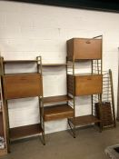 Mid Century modular shelving unit with six metal support structures, four modular units and nine