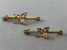 A Pair of 15ct Gold Brooches with floral sprays and each decorated with six seed pearls noth on