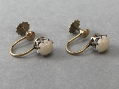 Pair of 9ct Gold earrings each set with a fire Opal