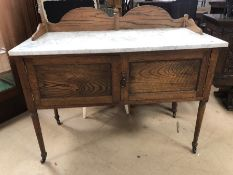 Oak wash stand with marble top on original castors, two drawers under
