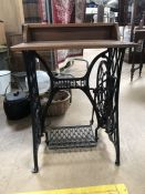 Work table adapted from the wrought iron base of a Singer sewing machine