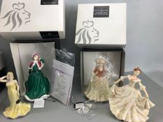 Two boxed Royal Doulton Figurines, Christmas Day & Autumn Stroll with two further figures by