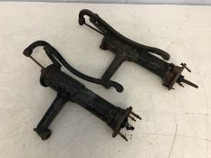Two vintage wrought iron water pumps