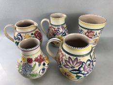 Five pieces of Poole pottery to include two jugs and vase in the CS design (one impressed 169 and
