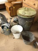 A good collection of galvanised metal items to include watering cans, coal scuttle, animal feeder