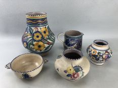 Five pieces of Poole pottery comprising three vases, jug and bowl. Includes XA design vase (approx