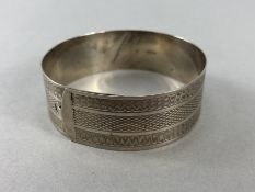 """Baptismal Silver bracelet with engine turned decoration and marked """"SILVER"""""""