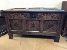 Three panelled oak coffer with carved detailing, approx 107cm x 49cm x 61cm tall