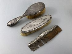 Birmingham Hallmarked Silver dressing table set two brushes and a comb (A/F)