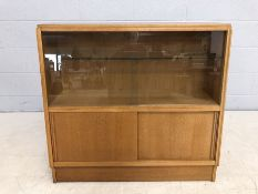 Mid Century G-Plan shelving unit with sliding door cupboards under and glass shelves above, approx
