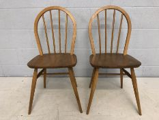 Pair of Ercol stick-back blond chairs