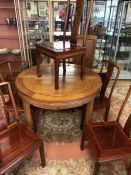 Imported Chinese rosewood extending circular (approx 112cm diameter) dining table with carved