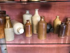 Collection of stoneware bottles and pots