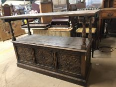 Heavily carved monk's bench with lidded compartment, three panels to front (A/F)