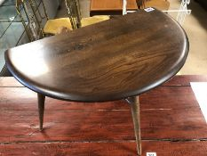 Circular low Ercol table with drop leaf
