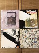 """4 Led Zeppelin LPs including """"Led Zeppelin"""", """"II"""" and """"IV"""" (all UK green & orange 70s pressings) and"""