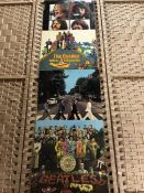 Four LPs by the Beatles: 'Let It Be', 'Yellow Submarine', 'Seargent Pepper's' etc