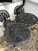 Two metal garden tables and two chairs