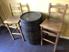 Beer barrel and two tall stools used as bar table