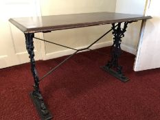 Wrought iron framed pub-style table