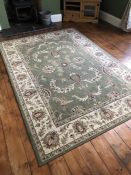 Large green ground rug, approx 294cm x 200cm