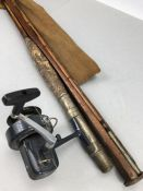 Vintage fishing equipment, a split cane rod with cork handle