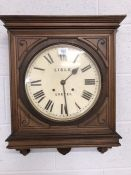 Wall clock inscribed 'Lisle Exeter' and 'Manufactured in the United States of America' in wooden