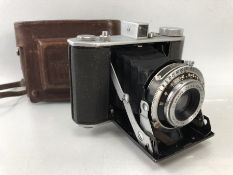 Olympus Six camera with Olympus Zuiko F/3.5 7.5cm lens. Takes 6 x 6 and 4.5 x 6. 1948 - 1956. With