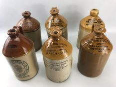Collection of six vintage cider flagons to include Ernest Green of Leek, Bates Bros of Bolton, Sykes