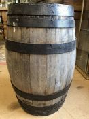 Wooden barrel with metal banding, approx 63cm in height