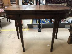 Card table with red baize under folding top