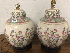 Pair of Chinese ceramic lamp bases with floral design, each approx 44cm in height