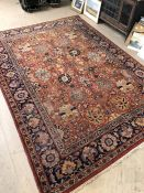 Large red/orange ground carpet with floral design, approx 340cm x 240cm