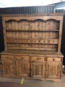 Large pine kitchen dresser with multiple drawers and cupboards under, approx 184cm x 48cm x 193cm