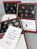 Three sets of Royal Mint United Kingdom Proof Collection leather bound Coin sets 1996, 1990 & 1992