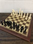 Chess set with soap stone pieces on a wooden board, approx 52cm x 52cm