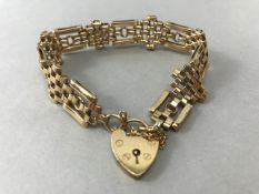 9ct Gold link Bracelet with 9ct Heart shaped Lock total weight 21.2g