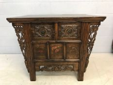 Eastern style chest with carved drawers and hand painted floral panels, carved flower detailing to