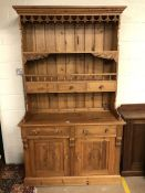 Pine kitchen dresser with carved detailing, drawers and cupboard under, approx 122cm x 51cm x
