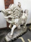 Sculpture: Very Large Chinese Dragon with a Child/ buddha riding on its back. Sculpture is white