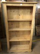 Pine bookcase, approx 83cm x 26cm x 150cm tall