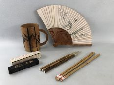 Chinese writing set in a bamboo mug to include bamboo tip pens, cased ink block and a folding fan